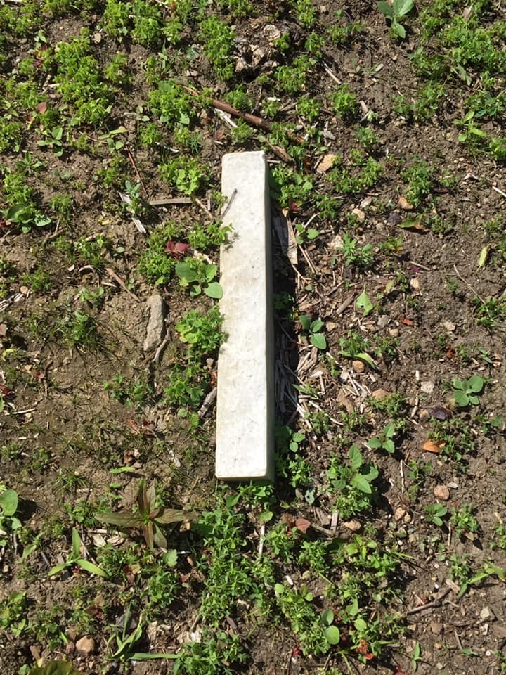 This is all the was visible of their base. Rob will dig the base up and level it.  The headstone broke off at ground level and did not suffer anymore damage.